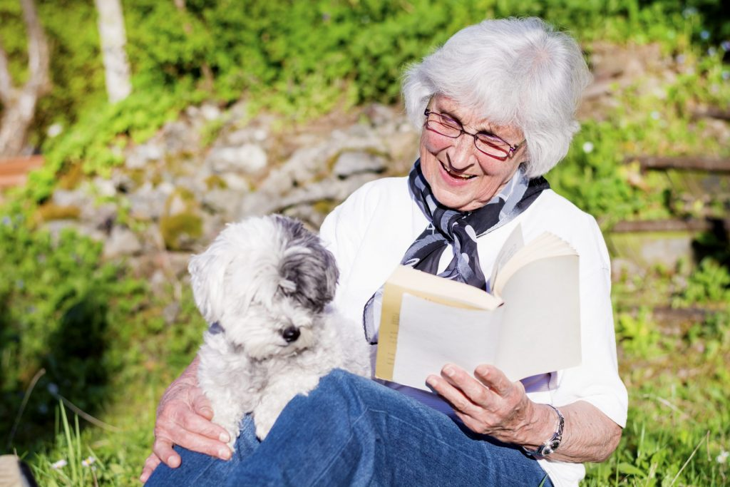 grandma reading with a dog